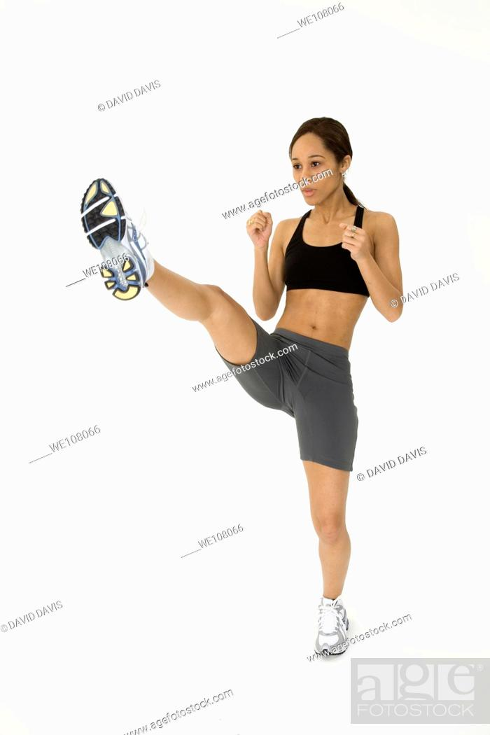 Stock Photo: Young African American woman working out.