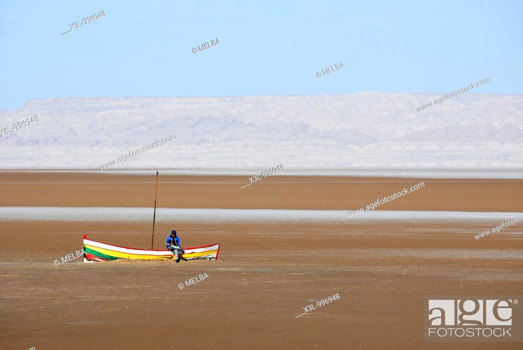 Stock Photo: Fisherman in Chott El Jerid salted lake, Tunisia.
