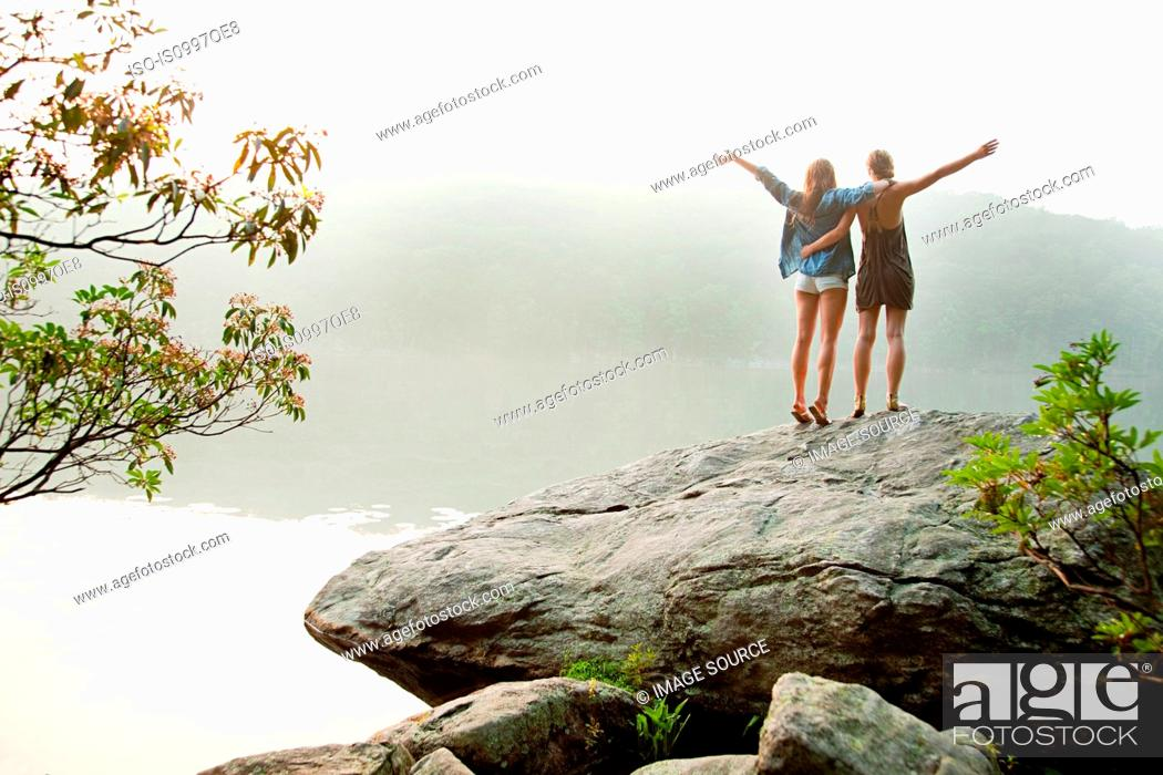 Stock Photo: Young women looking out over lake.
