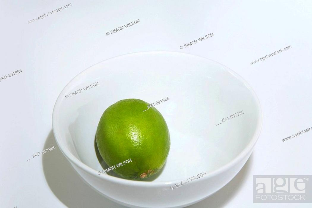 Stock Photo: lime in white bowl.