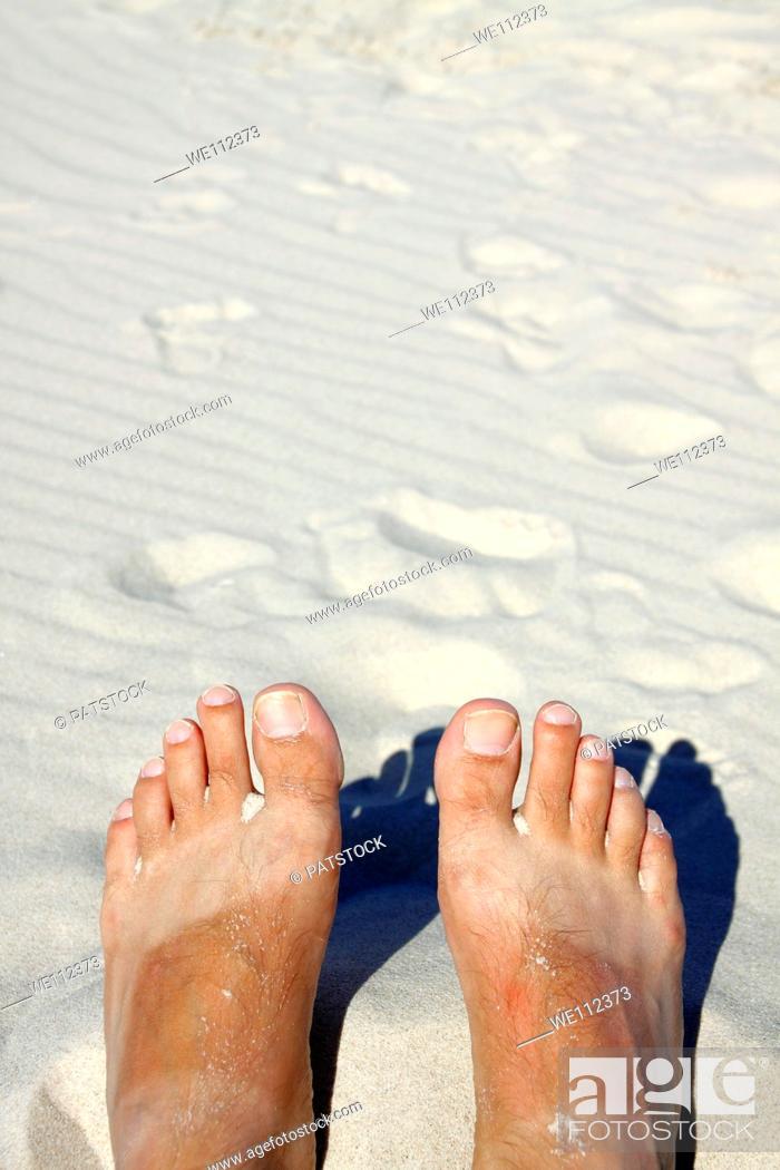 Stock Photo: Male feet on a Baltic Sea beach, Poland.