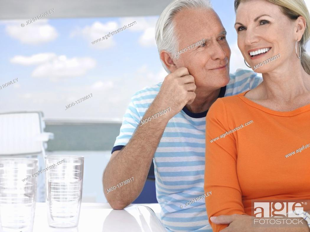 Stock Photo: Smiling middle-aged couple outdoors portrait.