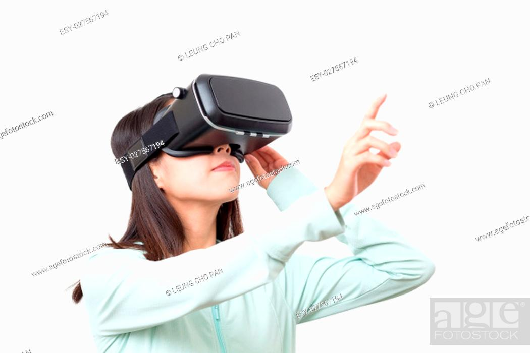 Stock Photo: Woman using VR device and finger pointing up.