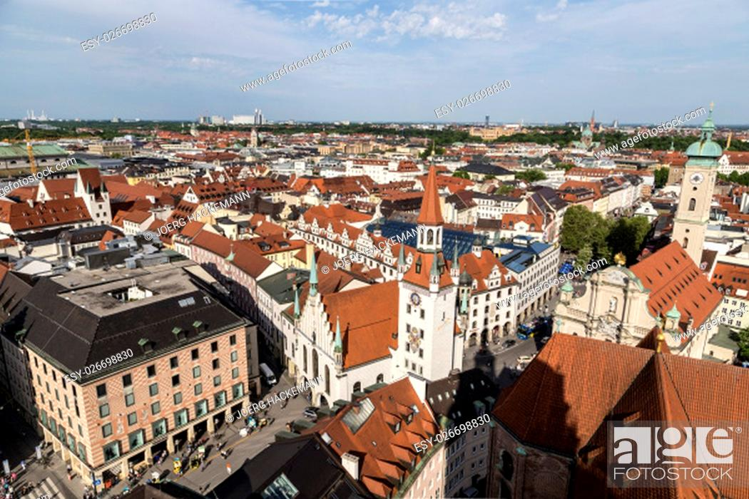 Stock Photo: Beautiful super wide-angle sunny aerial view of Munich, Bayern, Bavaria, Germany with skyline and scenery beyond the city, seen from the observation deck of St.