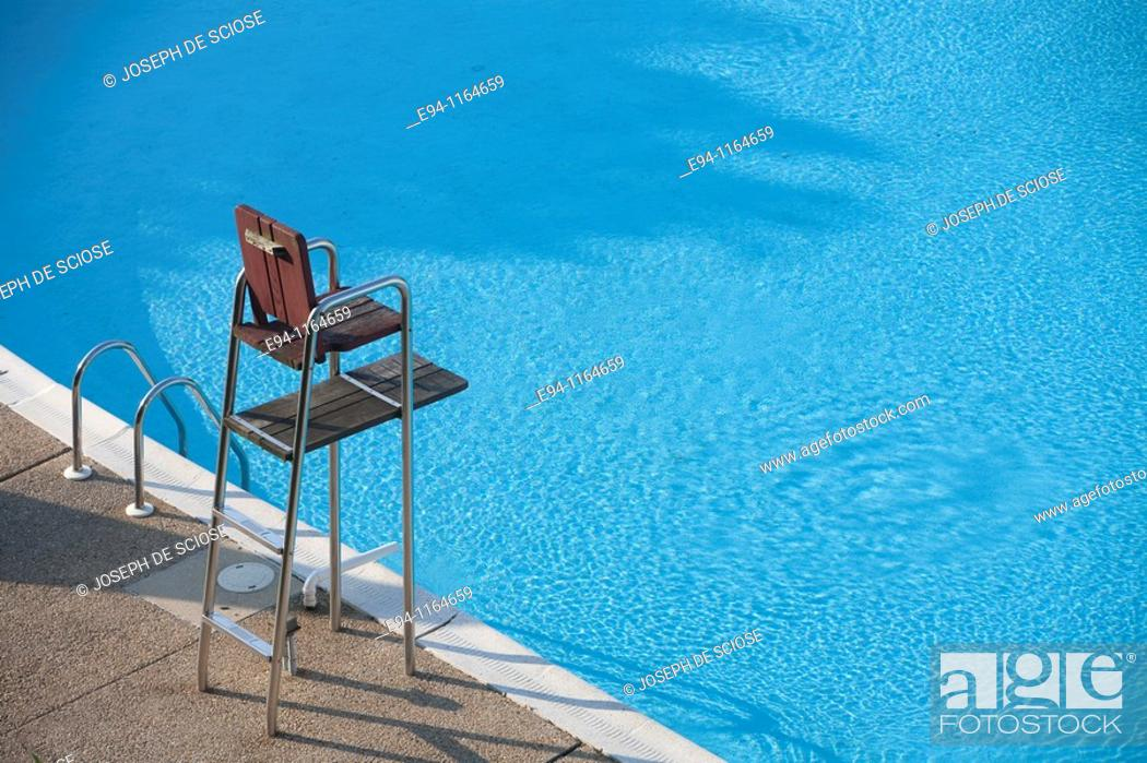 Imagen: A partial view of a motel swimming pool showing water and an empty life guard stand.