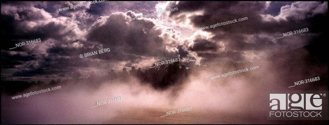 Stock Photo: Smoke beneath heavy clouds.