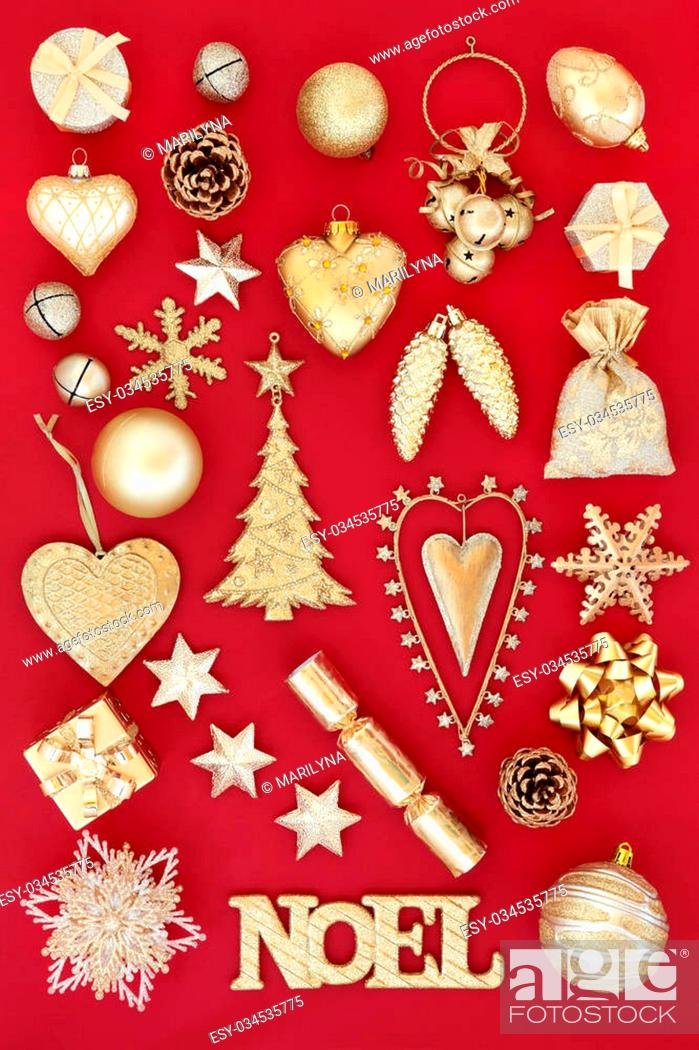 Photo de stock: Gold noel sign and christmas tree decorations and baubles over red background.