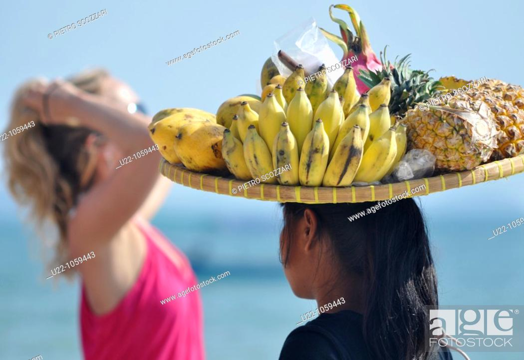 Stock Photo: Sihanoukville (Cambodia): fruit seller at Occheuteal Beach.