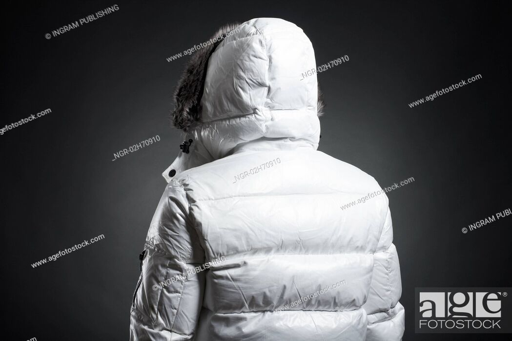 Stock Photo: Portrait of the young man in a white jacket.