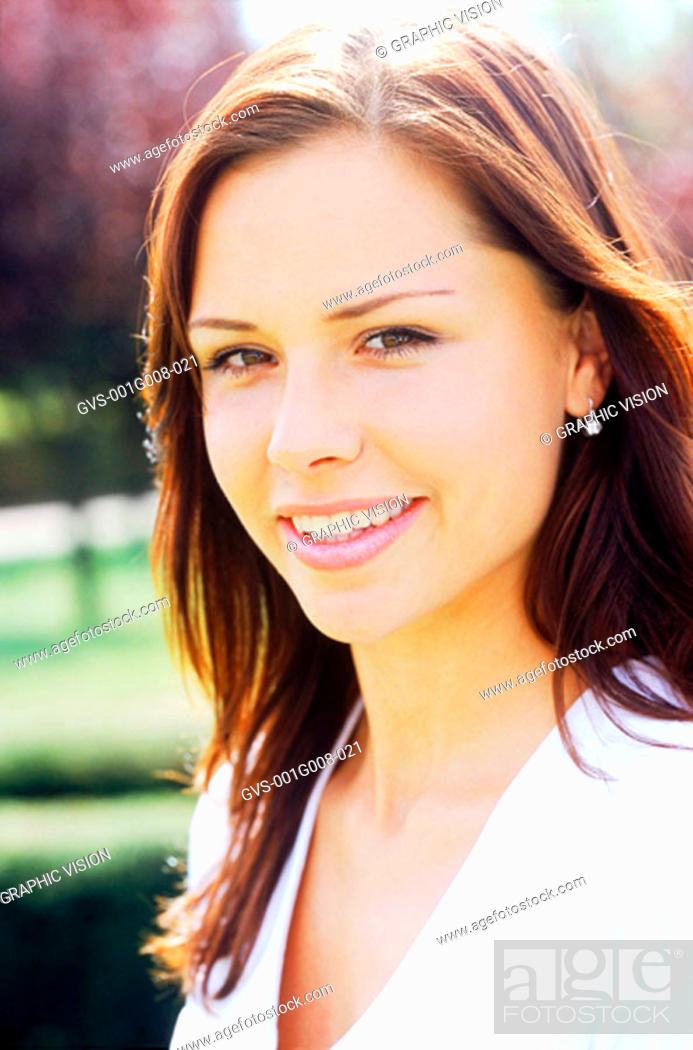 Stock Photo: Side profile of a young woman smiling.