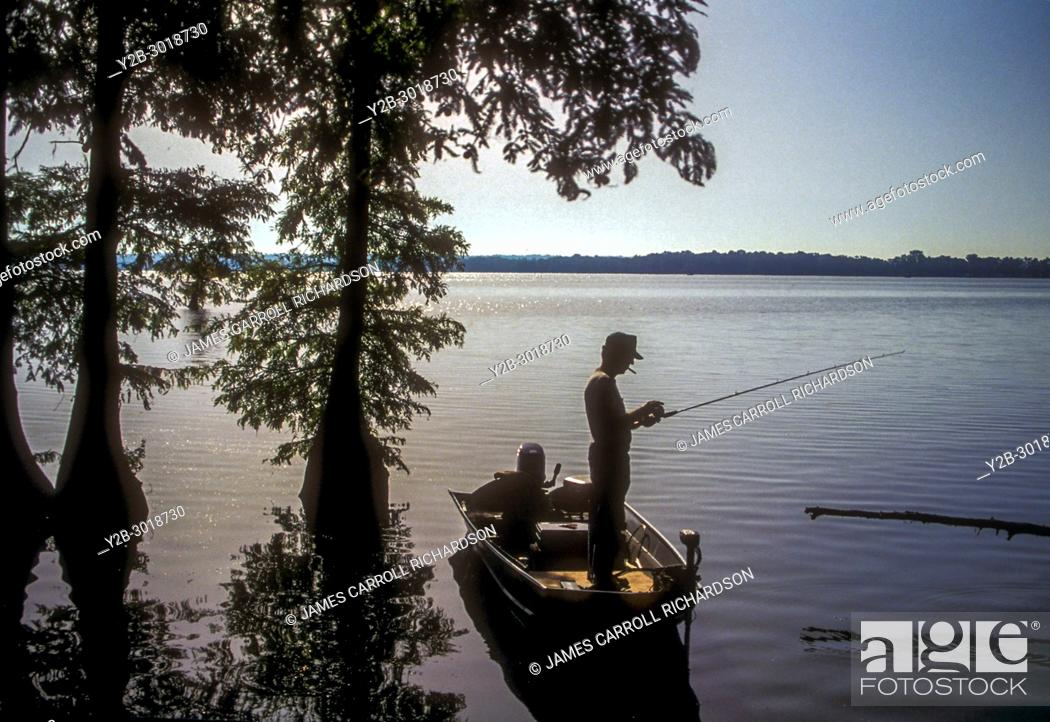 Stock Photo: Fisherman in boat at Reelfoot Lake in Tennessee.