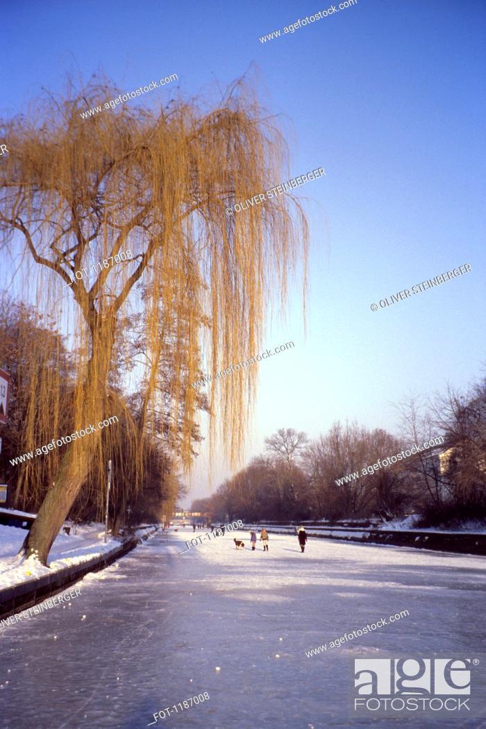 Stock Photo: People walking on the frozen Landwehr Canal in Berlin, Germany.