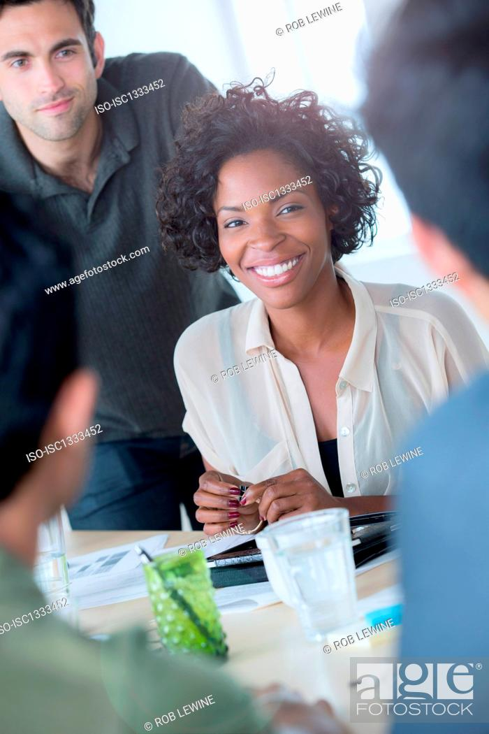 Stock Photo: Informal portrait of female office worker with colleagues.