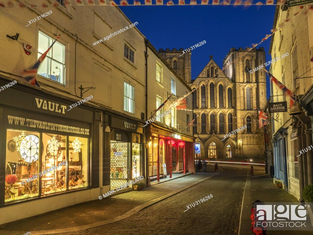 Stock Photo: Ripon Cathedral floodlit at dusk from Kirkgate Ripon North Yorkshire England.