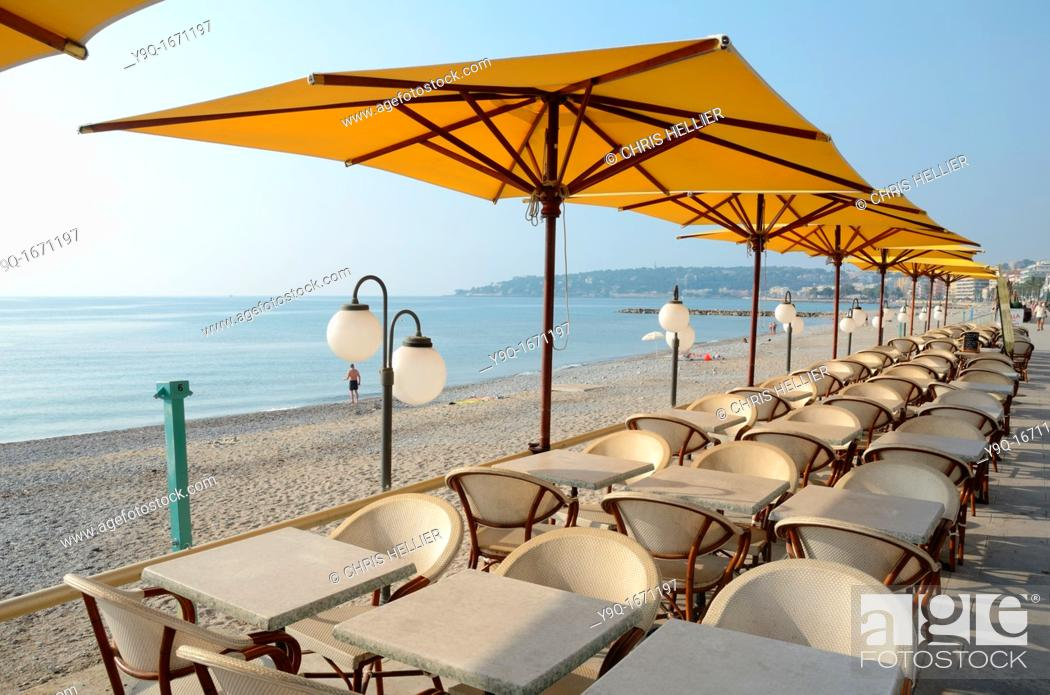 Stock Photo: Seafront and Empty Pavement Cafe Terrace Menton Alpes-Maritimes France.