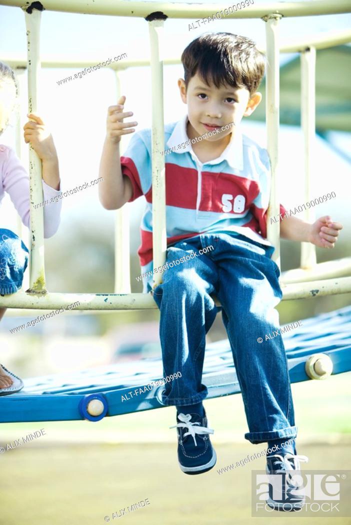 Stock Photo: Children on playground equipment.