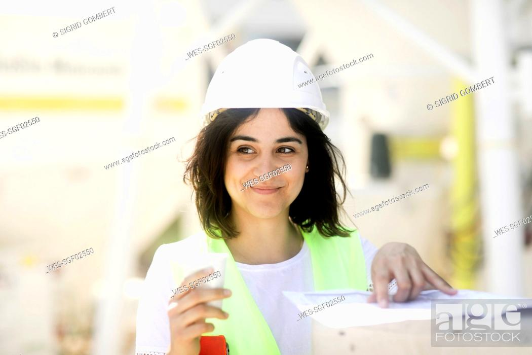 Stock Photo: Female construction engineer during work.