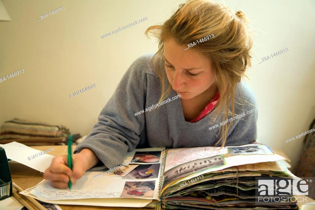 Stock Photo: image of teenage girl working on her art folder.