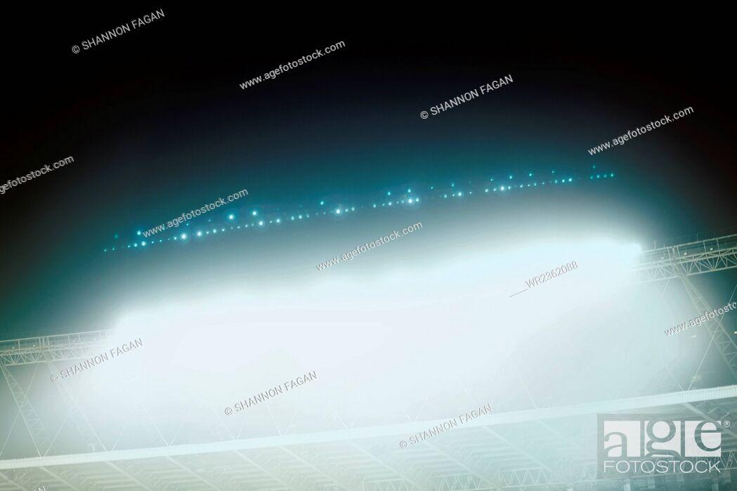 Imagen: View of stadium lights at night.
