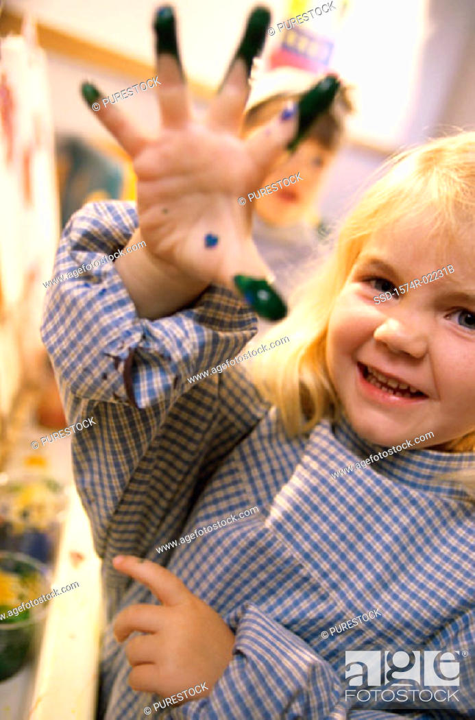 Stock Photo: Close-up of a girl with paint on her hand.