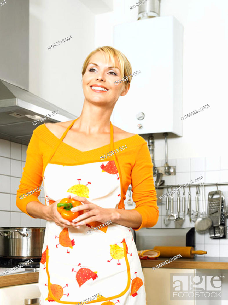 Stock Photo: Housewife holding a pepper.