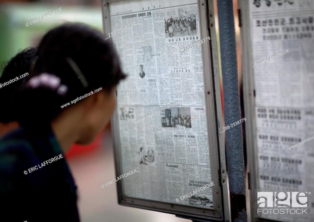 Reading News In Puhung Subway Station, Pyongyang, North Korea, Stock