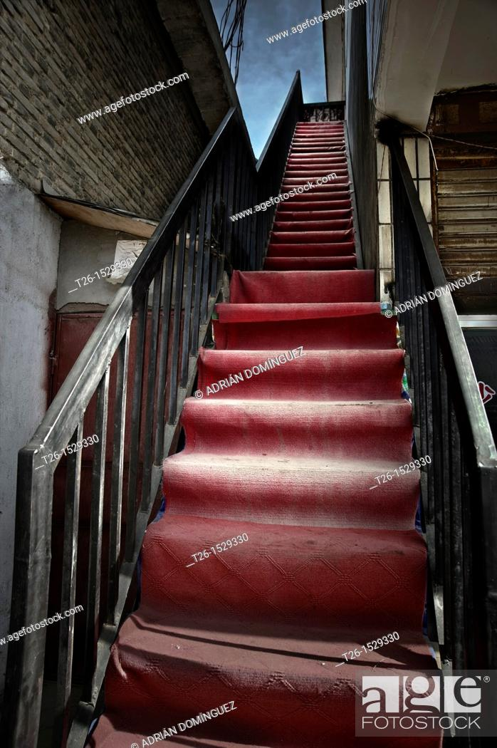 Stock Photo: Red steps in the street of Litang. China country.