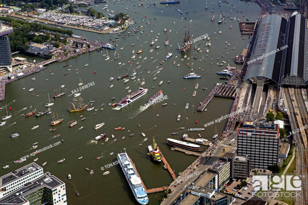 Stock Photo: Sail is the biggest maritime event in the world. More then hundred tallships visit Amsterdam. These vessels are bing accompanied by thousands of small dutch.