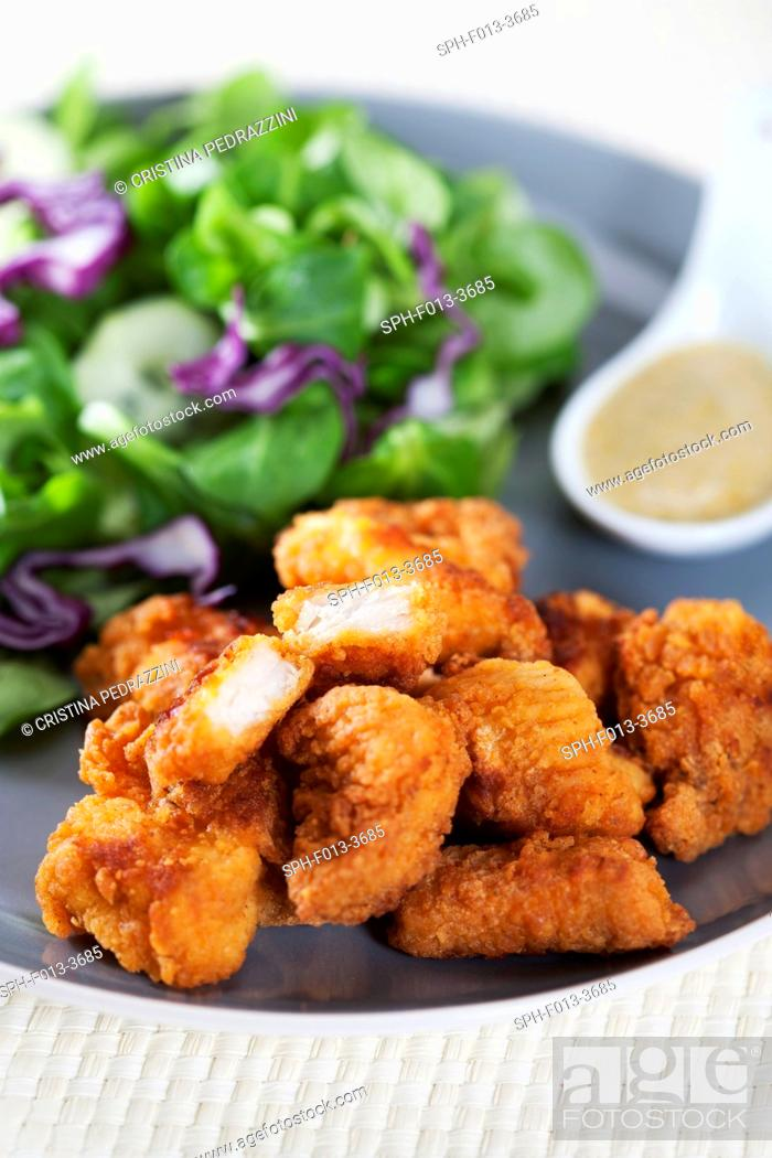 Stock Photo: Fried chicken with salad.
