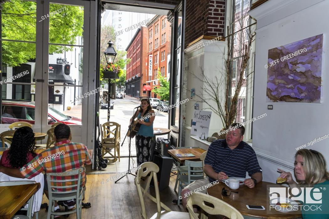Stock Photo Virginia Richmond Shockoe Slip District Urban Farmhouse Market Cafe Restaurant Coffeehouse Dining Musician Playing Guitar Woman