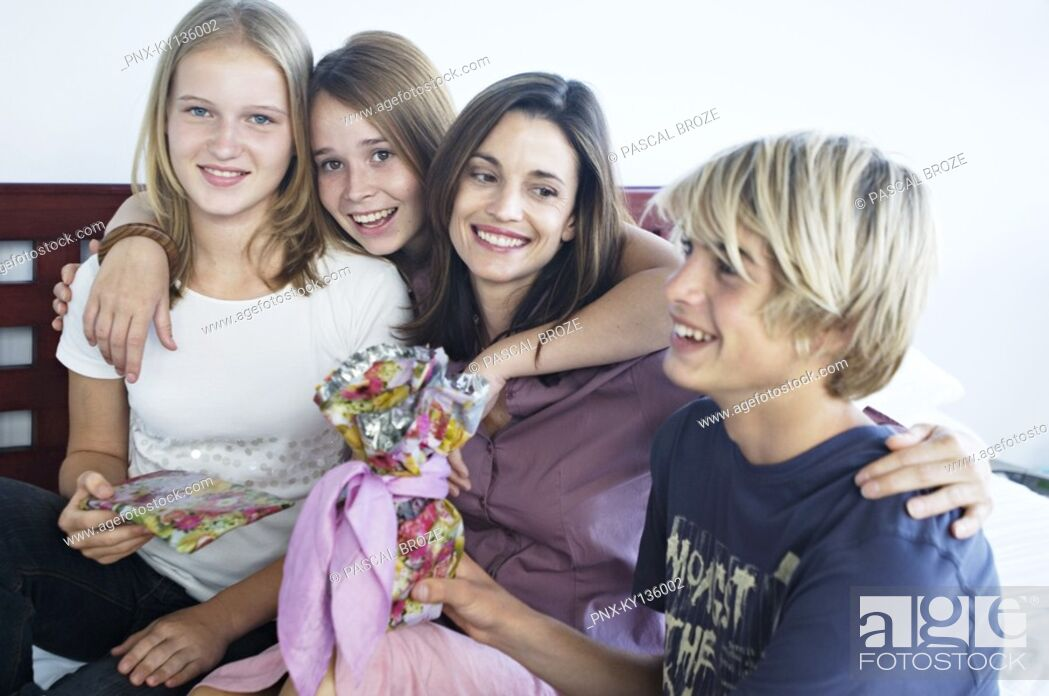 Stock Photo: Portrait of a mother and her three children teenagers, indoors.