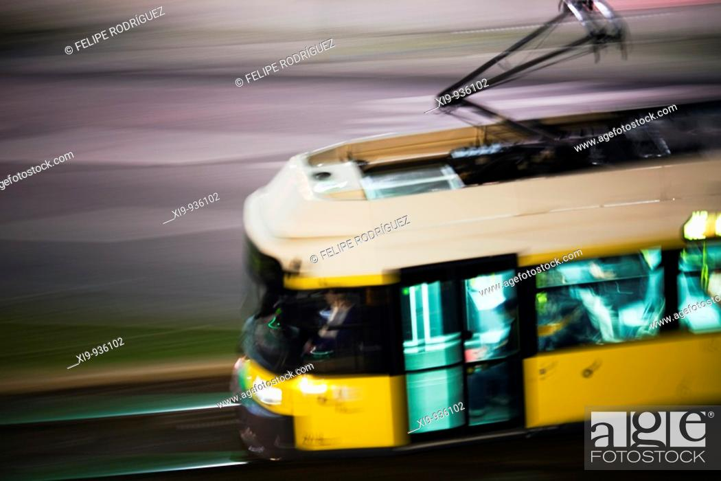 Stock Photo: Panning shot of a tram by night, Berlin, Germany.