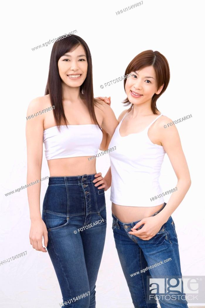 Stock Photo: Two young women, smiling, front view.