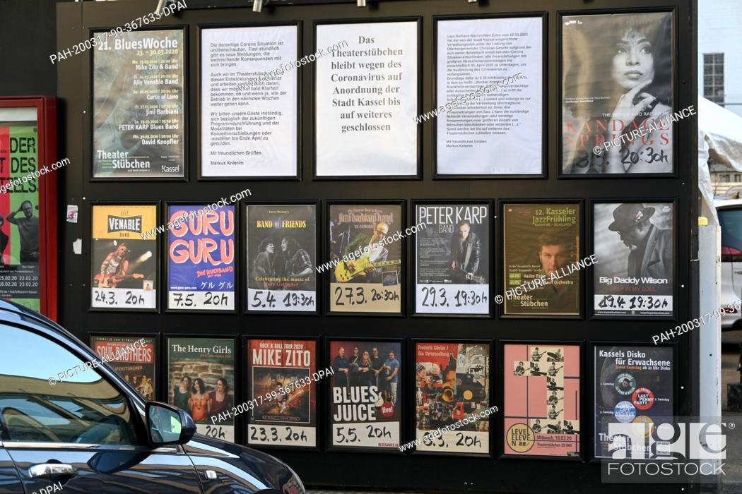 """Stock Photo: 17 March 2020, Hessen, Kassel: Between the concert event posters of the club """"""""Theaterstübchen"""""""" hangs the information about the closing due to the coronavirus."""