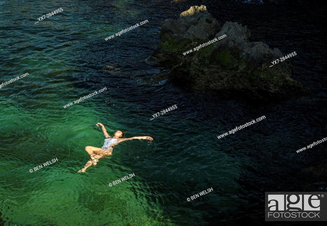 Stock Photo: Young woman alone at a beach. Tarifa, cadiz, Costa de la Luz, Andalusia, Spain.