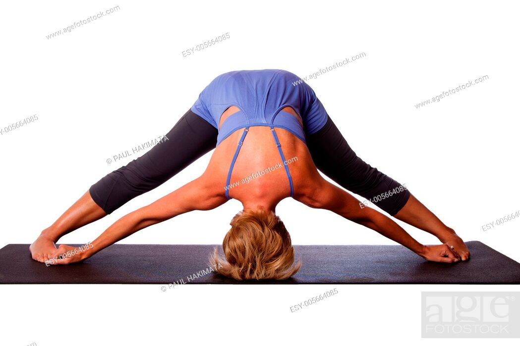 Stock Photo: Beautiful healthy woman doing inversion Standing Intense Spread Leg Prasarita Padottanasana yoga pose with head on floor, on white.