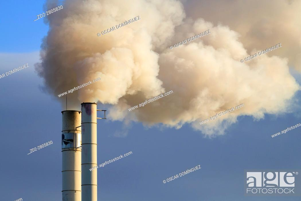 Stock Photo: The smokestack of a fodder procesing plant operated by Aldahra Fagavi. Ivars d'Urgell. Lleida province. Catalonia. Spain.