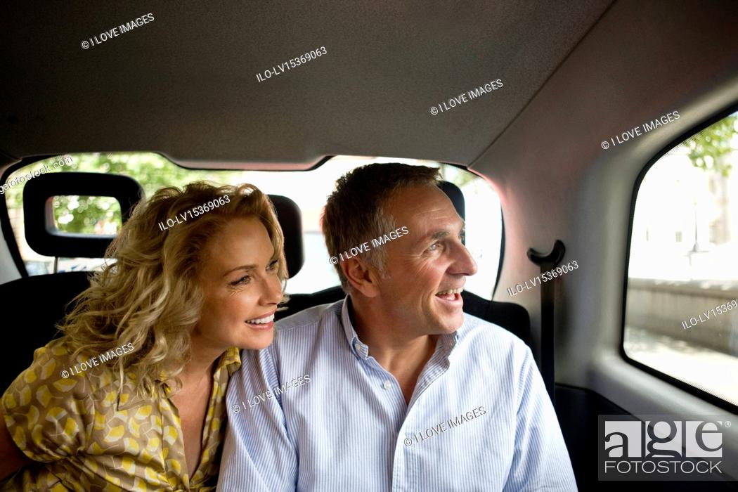 Stock Photo: A middle-aged couple in a London taxi, admiring the view.