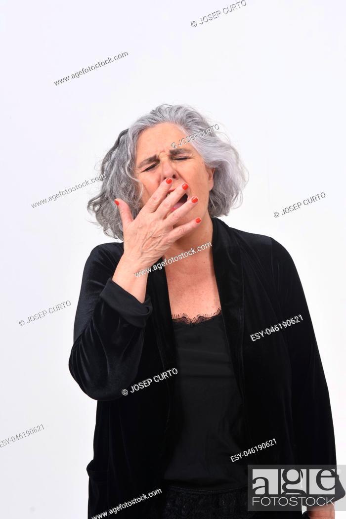 Stock Photo: woman yawning on white background.