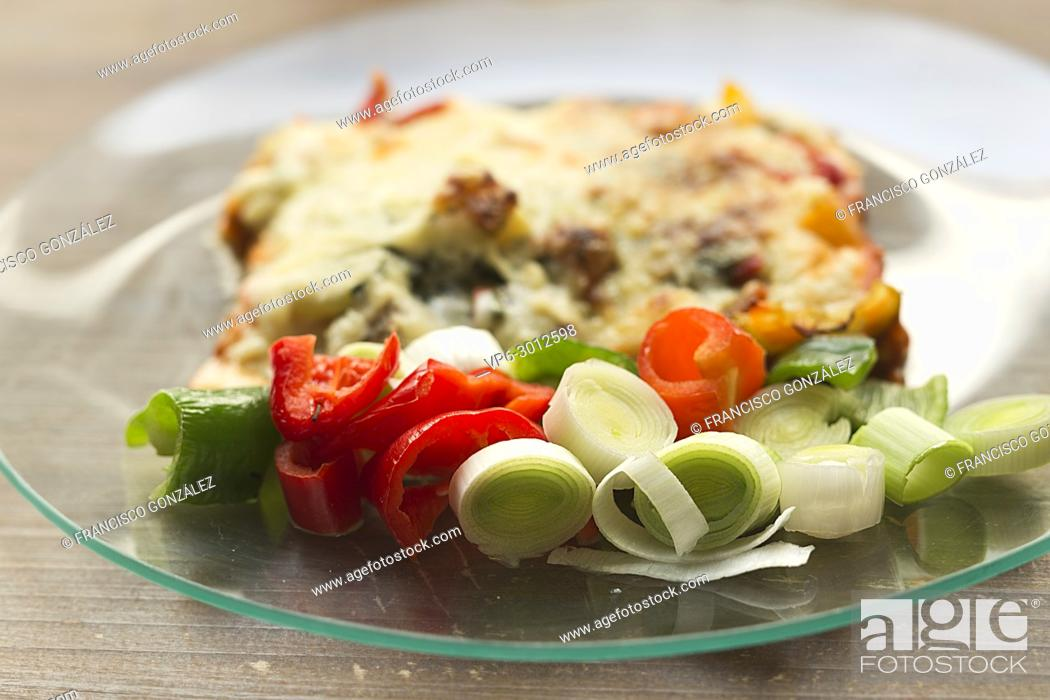 Photo de stock: Italian gastronomy called lasagna in a glass dish on a wooden background.