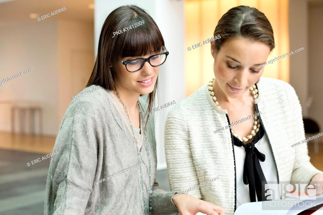Stock Photo: Two businesswomen discussing in an office.