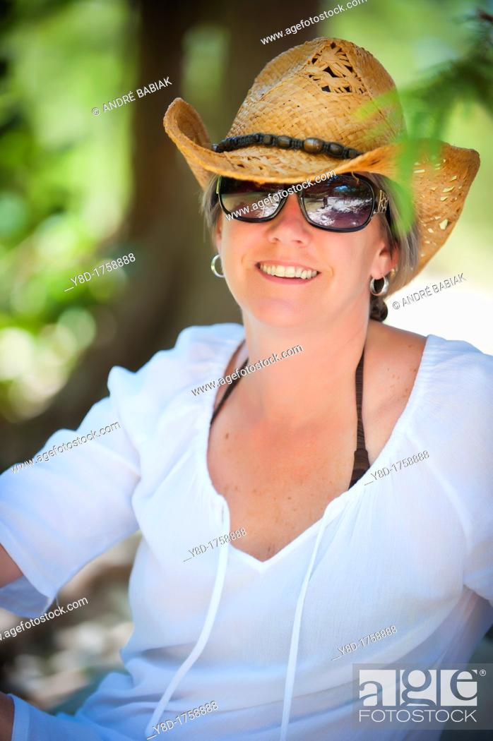 Stock Photo: Outdoor portrait of 45 years old caucasian woman.