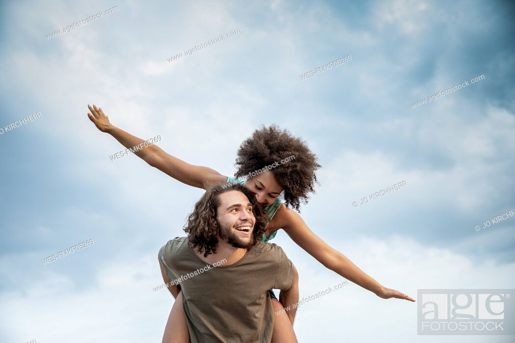 Stock Photo: Happy carefree couple outdoors.