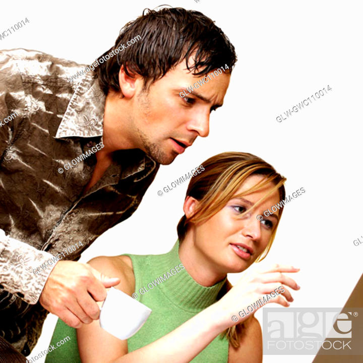 Stock Photo: Businessman and a businesswoman discussing.