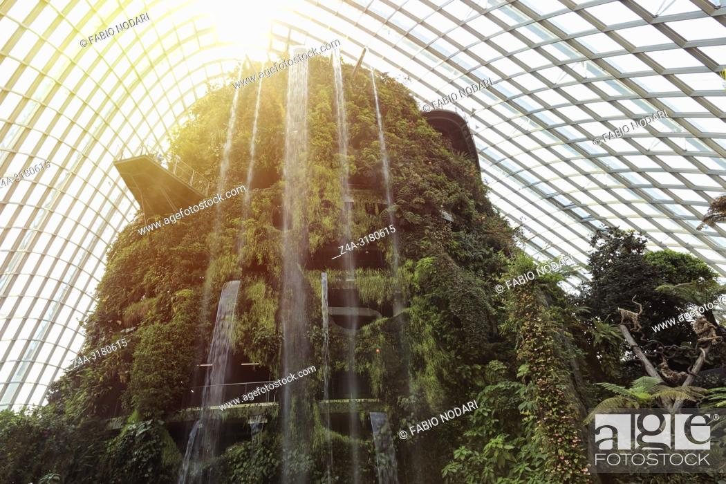 Stock Photo: Waterfall inside the Cloud Forest Dome Gardens by the Bay in Singapore.