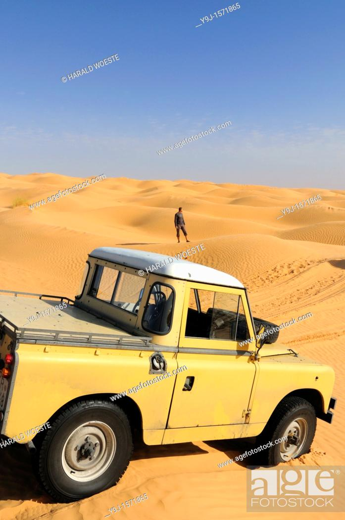 Stock Photo: Africa, Tunisia, nr  Tembaine  Looking out for the right track  Desert tourist and his Land Rover Series 2a Truck Cab in a sandfield close to Tembaine on the.