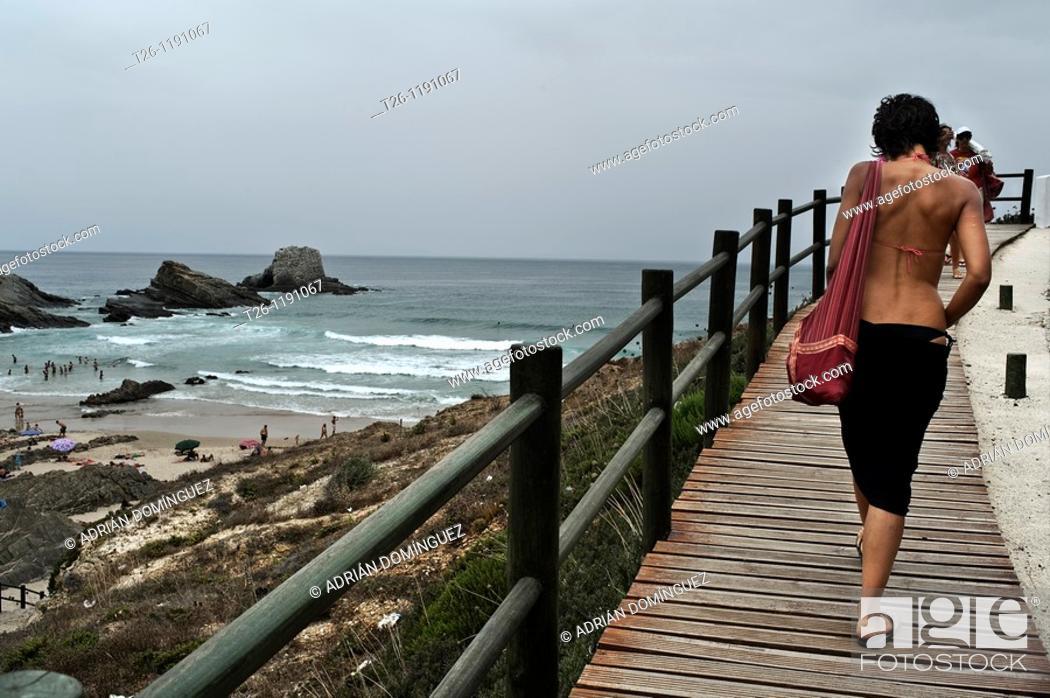 Stock Photo: woman walks back near the beach.