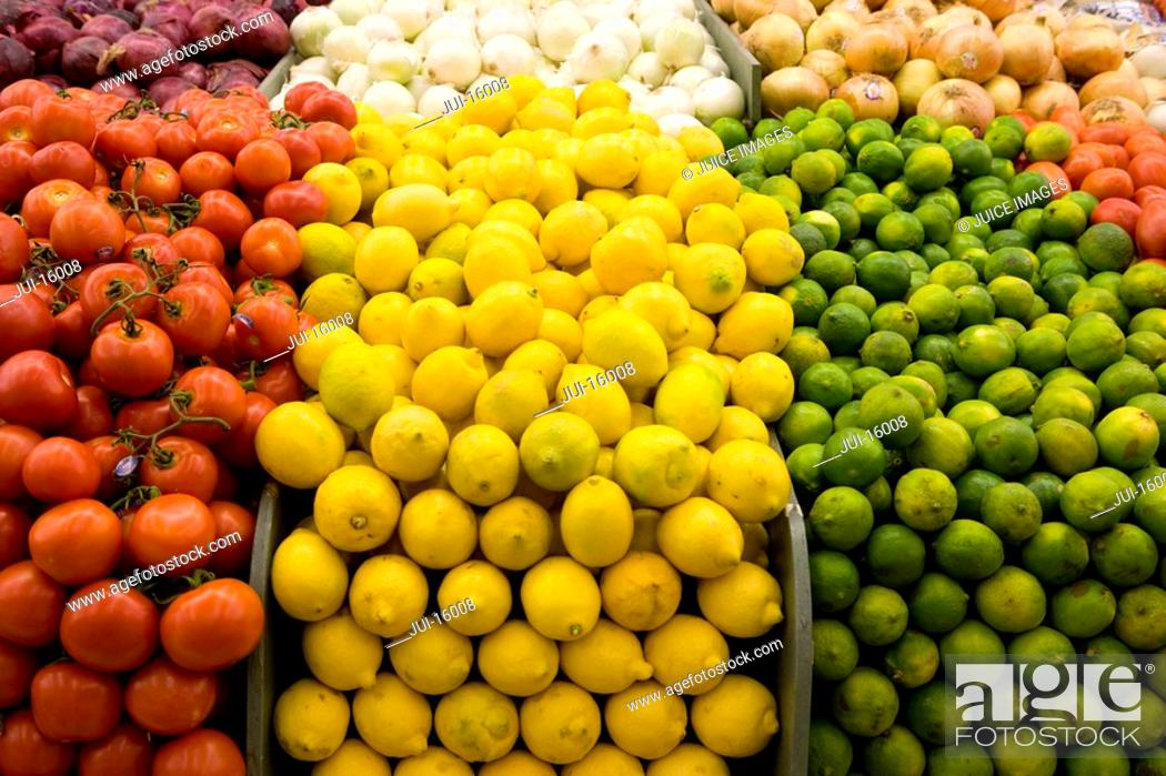Stock Photo: Close up of tomatoes, lemons and limes.