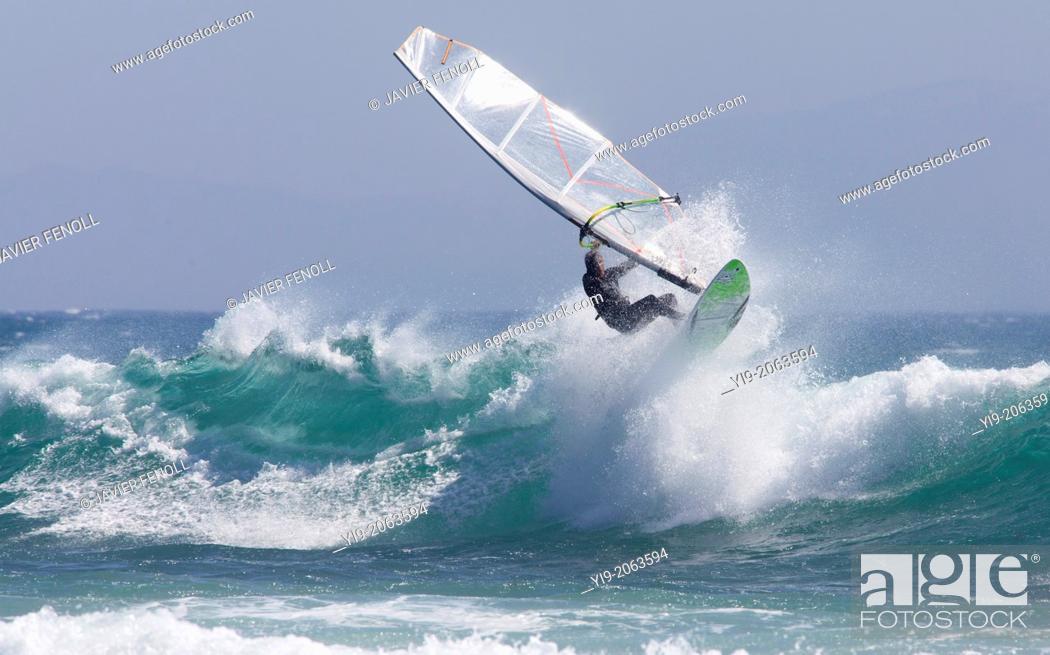 Stock Photo: windsurfer surfing a wave.