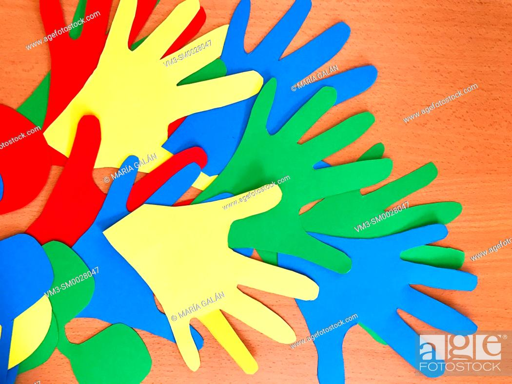 Stock Photo: Hands made with color cardboards.